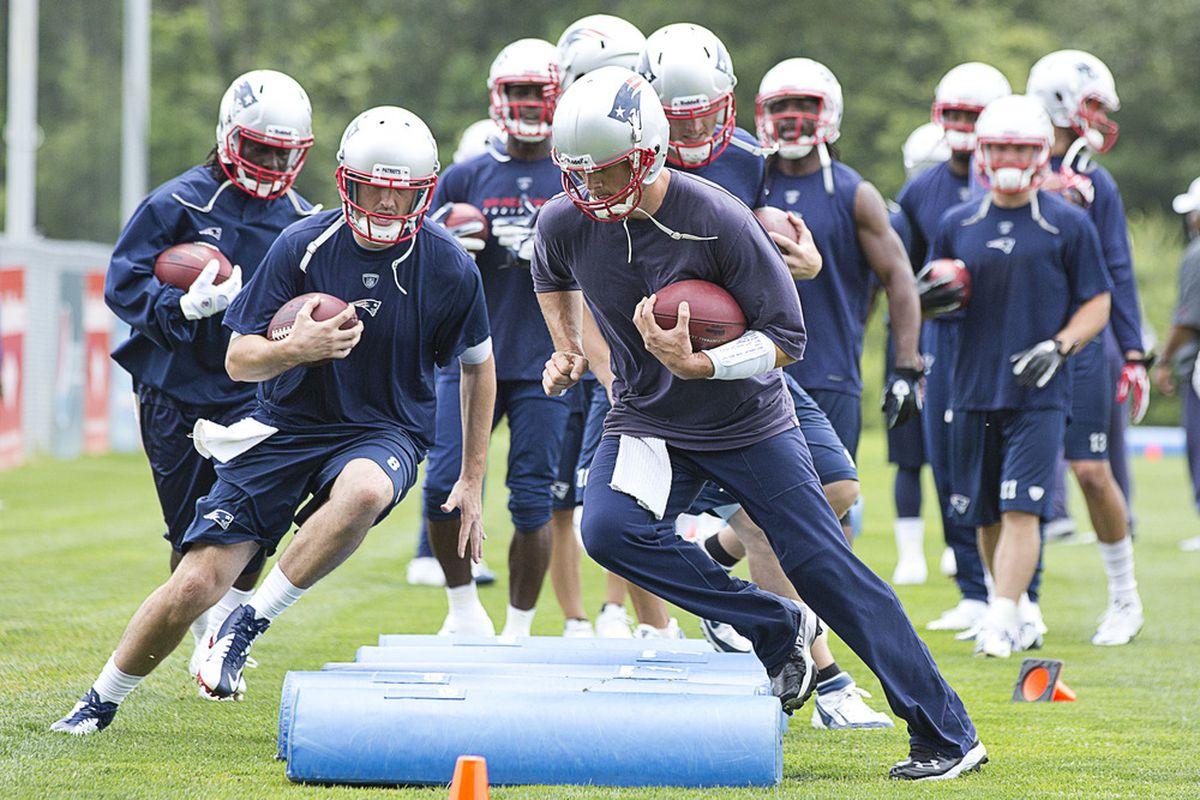 <em>Tom Brady leads a drill during Day 1 of minicamp</em>.
