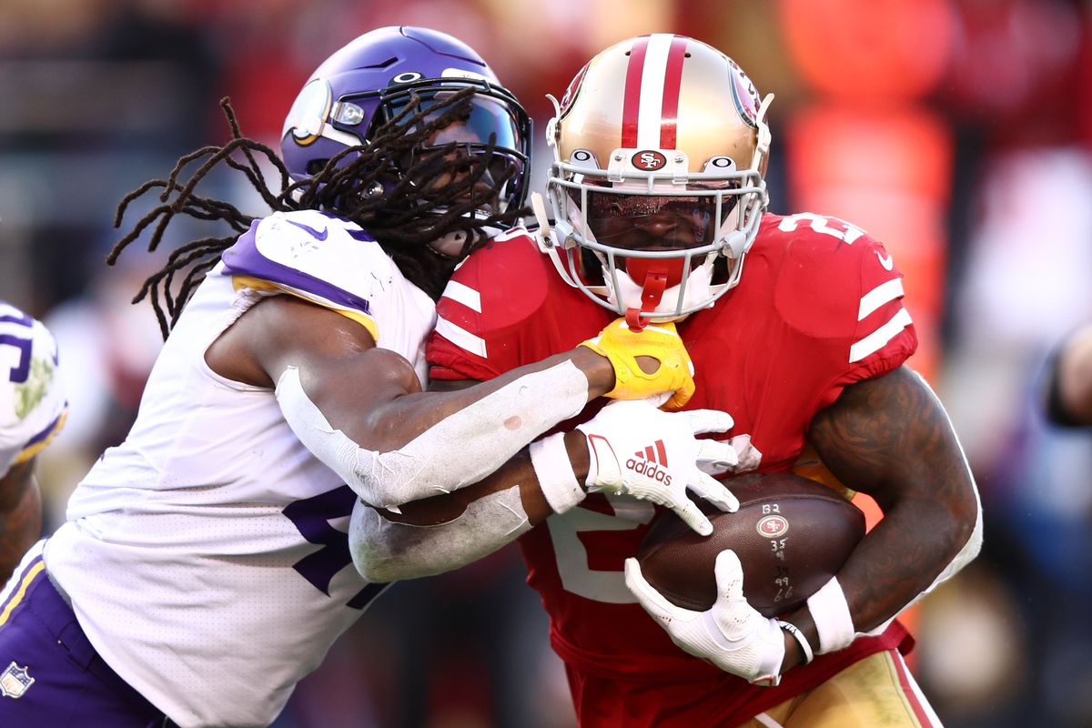 Tevin Coleman #26 of the San Francisco 49ers runs the ball against Anthony Harris #41 of the Minnesota Vikings during the second half of the NFC Divisional Round Playoff game at Levi's Stadium on January 11, 2020 in Santa Clara, California.