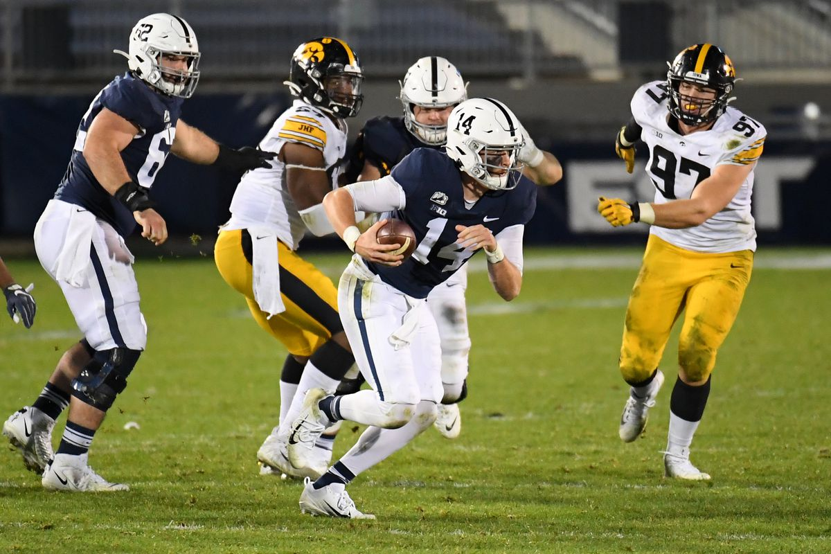 Sean Clifford avoid Iowa defenders while trying to make a play.
