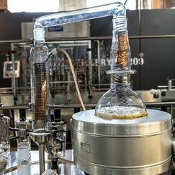 Hillesland distills small batches of the eight to eleven botanicals individually with this still.