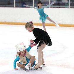 Vivian Torsak helps sister Mila at the Utah Olympic Oval in Kearns on Thursday, June 17, 2021.