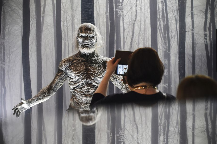 "A woman takes a picture of a white walker from HBO's ""Game of Thrones"" on display in an exhibition of the popular tv series in Berlin, Germany, on May 13, 2015."
