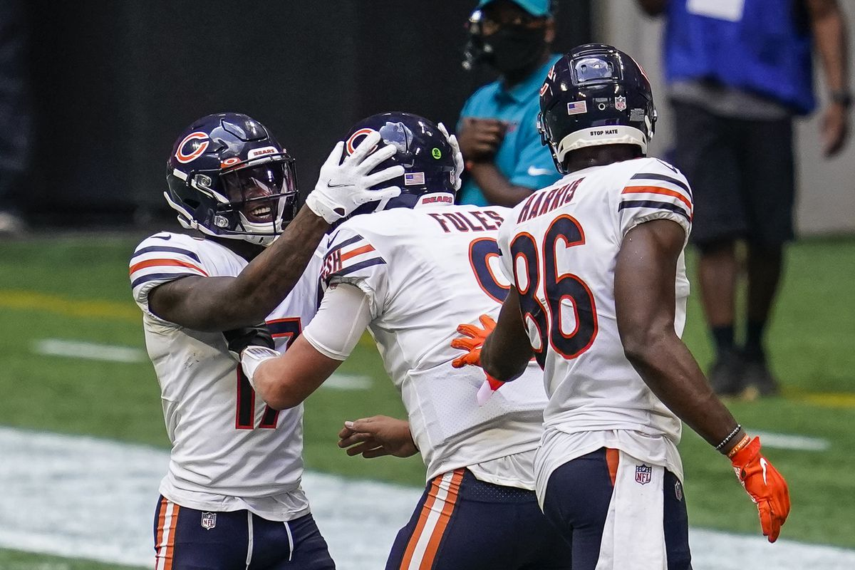 Chicago Bears wide receiver Anthony Miller quarterback Nick Foles and tight end Demetrius Harris react on the field after the Bears scored the go ahead touchdown against the Atlanta Falcons during the fourth quarter at Mercedes-Benz Stadium.