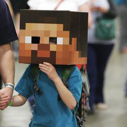 A young attendee walks through Comic Con at the Salt Palace in Salt Lake City Thursday, April 17, 2014.