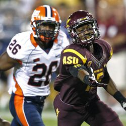 Arizona State wide receiver Rashad Ross (15) can't pull in a pass as Illinois defensive back Justin Green (26) defends during the first half of an NCAA college football game, Saturday, Sept. 8, 2012,in Tempe, Ariz.