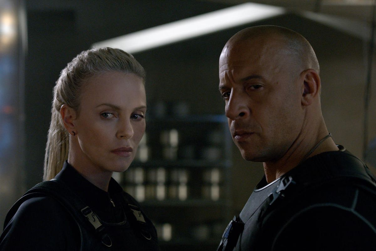 """Charlize Theron and Vin Diesel in the most recent installment of the Fast and Furious films, """"The Fate of the Furious."""" Universal owns the rights to the Fast and Furious franchise."""