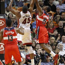 Miami Heat's Dexter Pittman (45) recovers a rebound against Washington Wizards' Jordan Crawford (15) in the first half of an NBA basketball game in Miami, Saturday, April 21, 2012.