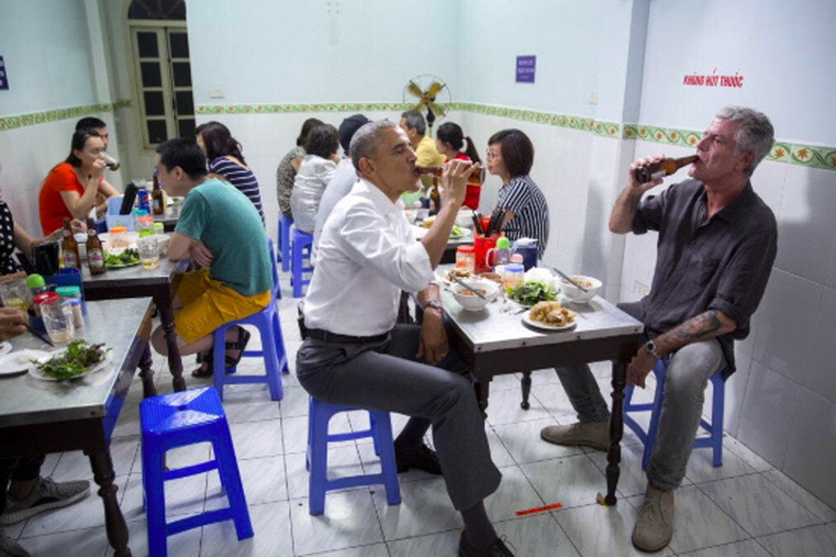 President Barack Obama and Anthony Bourdain share a meal and a beer in Hanoi, Vietnam, in 2016.