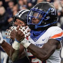 BYU wide receiver Keanu Hill, left, reaches for a pass as Boise State safety Tyreque Jones defends during an NCAA college football game at LaVell Edwards Stadium in Provo on Saturday, Oct. 9, 2021.