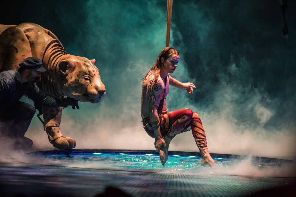 """A strap act performed over a pool of water includes the presence of a man-motored jaguar in Cirque du Soleil's """"Luzia.""""  MATT BEARD"""