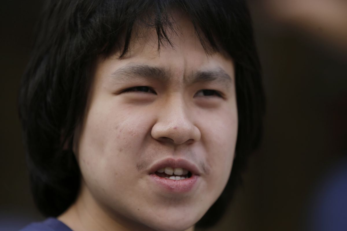 Amos Yee, a teenage blogger from Singapore, talks to reporters outside of the U.S. immigration field office after being released from federal custody following a U.S. immigration appeals court's decision to uphold his bid for asylum, Tuesday, Sept. 26, 2017, in Chicago.