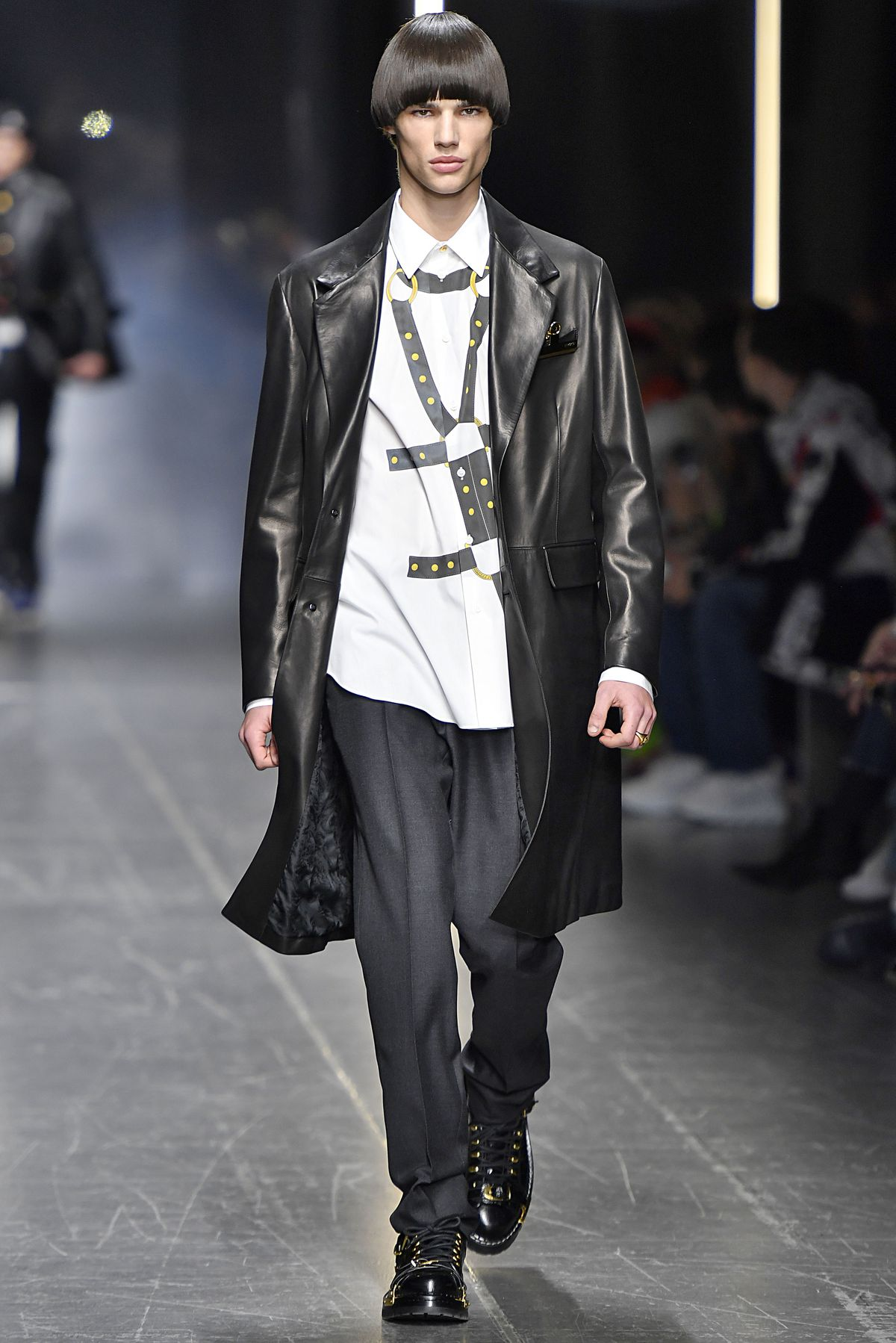 75da34d9f9fd A look from Versace s fall winter 2019 collection that includes a leather  coat and a