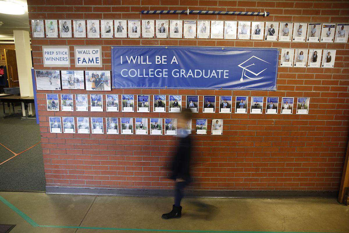 A student walks through the hallway of a Denver charter school.