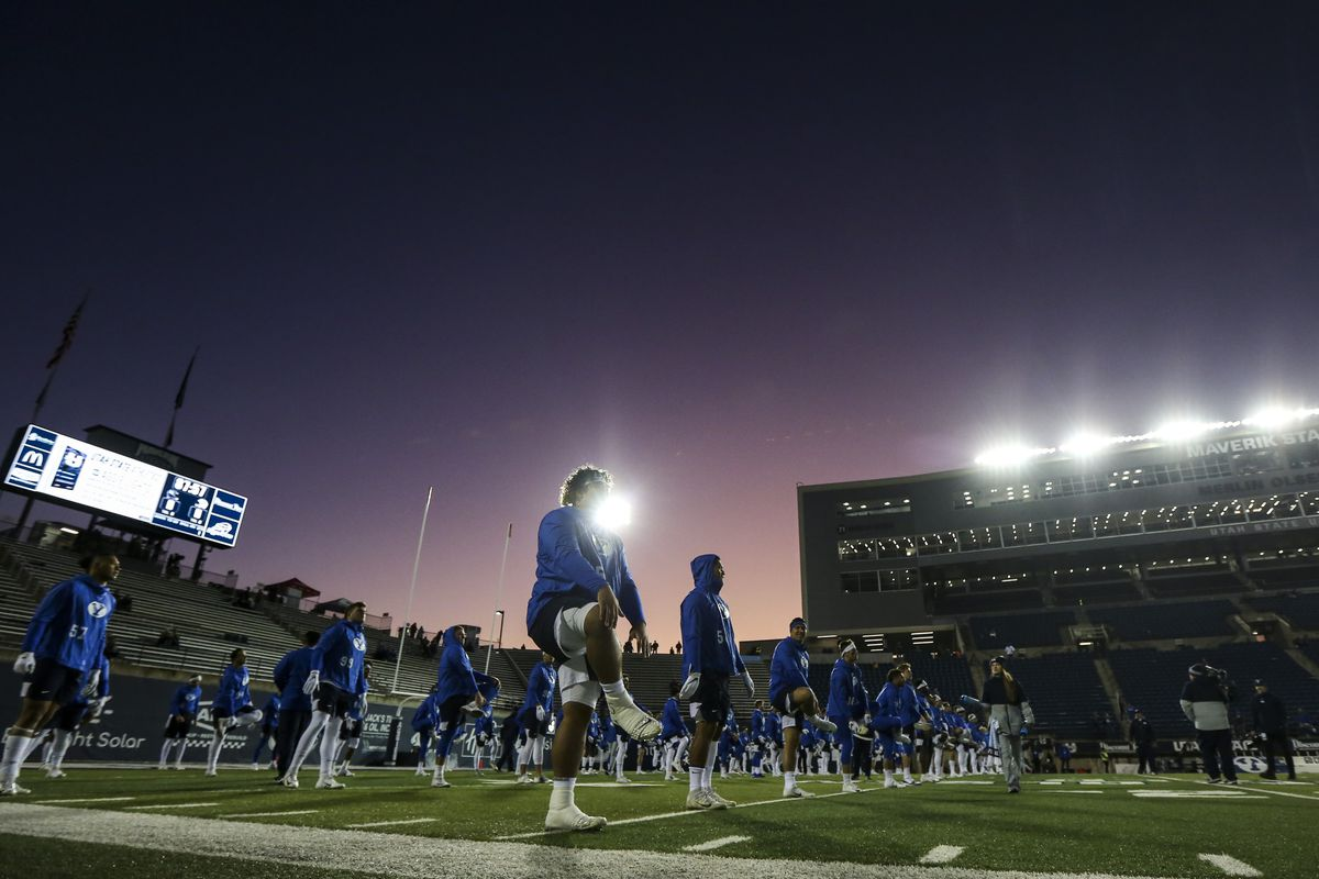 The Brigham Young Cougars warm-up before the start of a NCAA football game between the Brigham Young Cougars and the Utah State Aggies at Maverik Stadium in Logan on Saturday, Nov. 2, 2019.