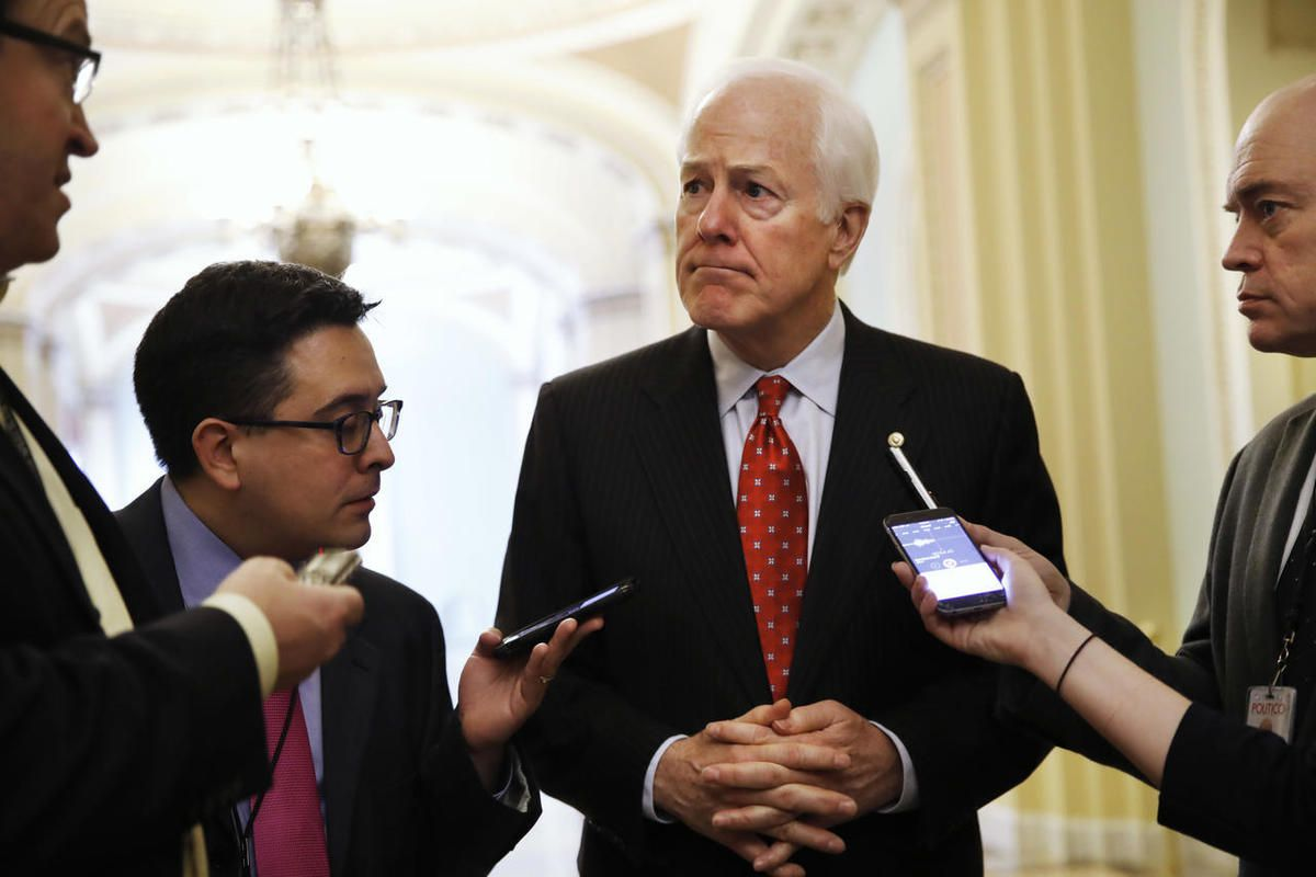 FILE - In this May 10, 2017 file photo, Senate Majority Whip John Cornyn of Texas talks with reporters on Capitol Hill in Washington. President Trump and his GOP allies on Capitol Hill have made it through nearly half their first year in power without a s