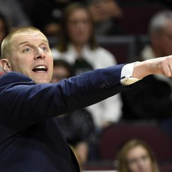 Utah Valley coach Mark Pope calls to his team during the second half of an NCAA college basketball game against Seattle in the first round of the Western Athletic Conference tournament Thursday, March 9, 2017, in Las Vegas.