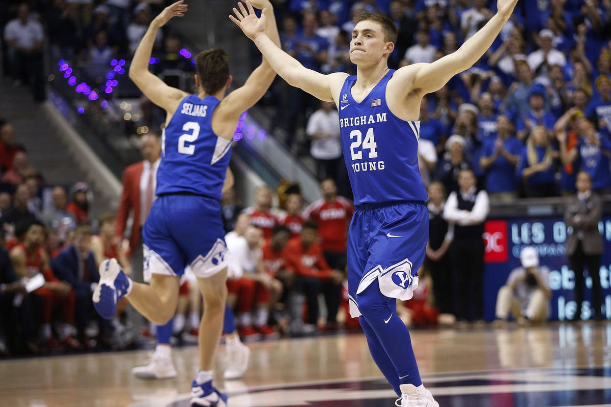 Brigham Young Cougars guard McKay Cannon (24) and Brigham Young Cougars guard Zac Seljaas (2) celebrate the win over Utah in Provo on Saturday, Dec. 16, 2017. BYU won 77-65.