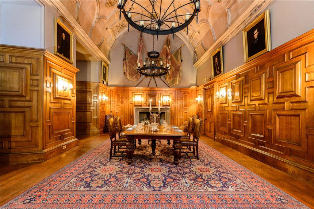 Dining room with carved wood walls