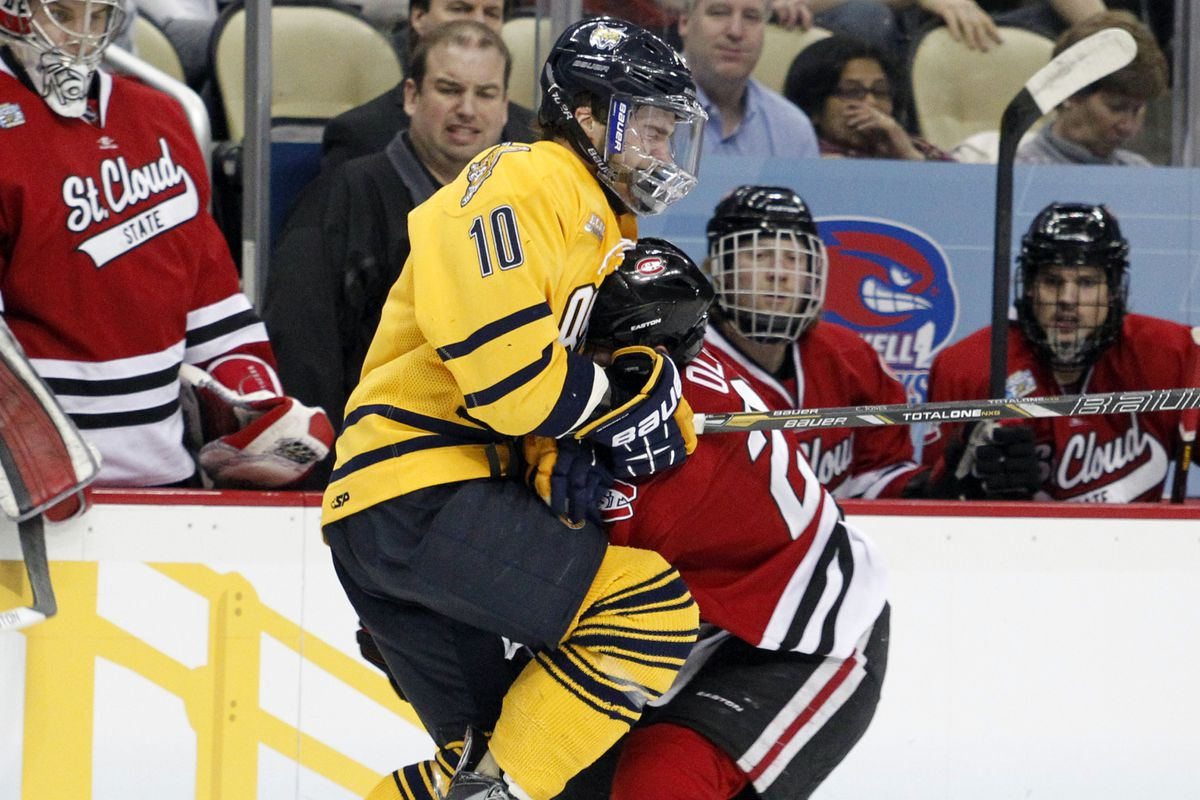 Quinnipiac's Connor Jones makes contact with a St. Cloud player in the 2013 Frozen Four.