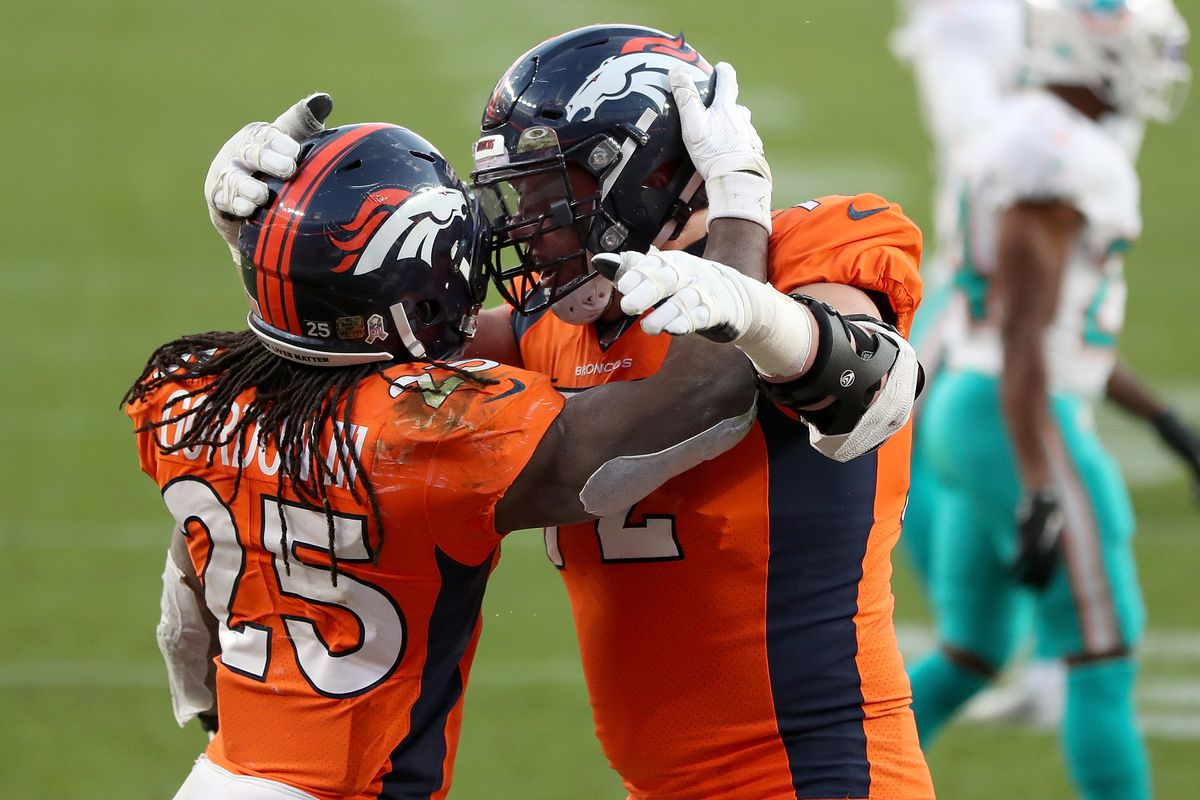 Garett Bolles #72 of the Denver Broncos celebrates the touchdown of Melvin Gordon #25, to take a 20-10 lead over the Miami Dolphins during the third quarter at Empower Field At Mile High on November 22, 2020 in Denver, Colorado.