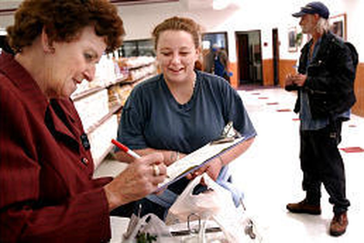 Sister Ruth Morgan helps Thunder Buist and her father, Bruce Warner, find everything on the family's grocery list at the LDS Bishop's Storehouse.