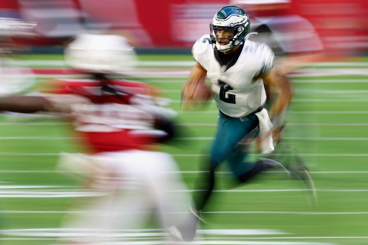 Quarterback Jalen Hurts #2 of the Philadelphia Eagles scrambles with the football against the Arizona Cardinals during the third quarter of the NFL game at State Farm Stadium on December 20, 2020 in Glendale, Arizona.
