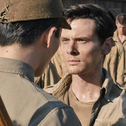"""The Bird (Miyavi), left,  torments Louis Zamperini (Jack O'Connell) in """"Unbroken,"""" an epic drama that follows the incredible life of Olympian and war hero Zamperini who, along with two other crewmen, survived in a raft for 47 days after a near-fatal plane crash in WWII — only to be caught by the Japanese Navy and sent to a prisoner-of-war camp."""