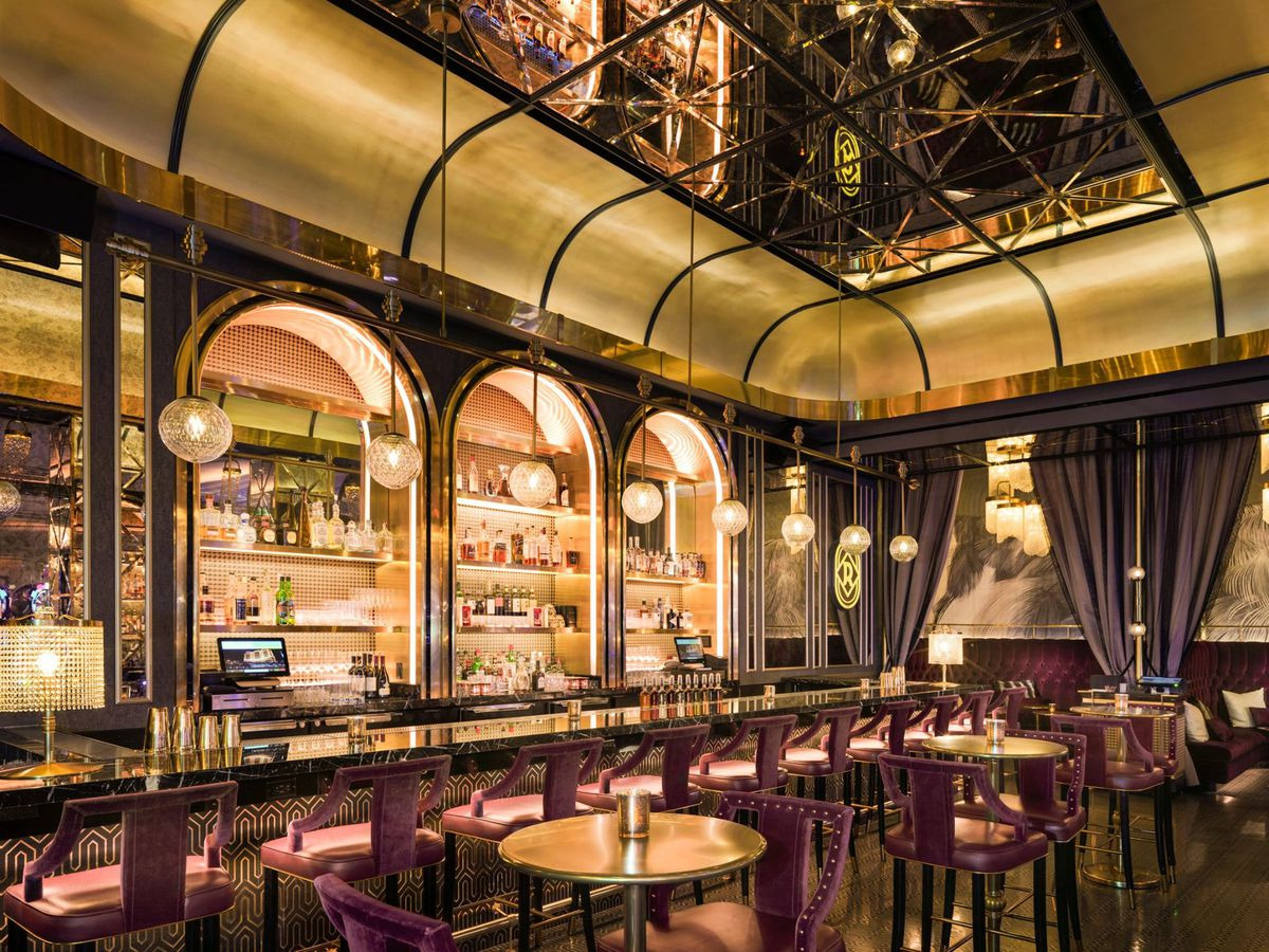An Art Deco bar with gold and rose touches.