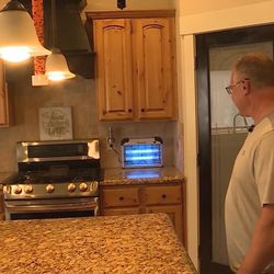 Brian Olenslager keeps a fly zapper is also on the counter in his Lehi home Friday, Aug. 4, 2017.