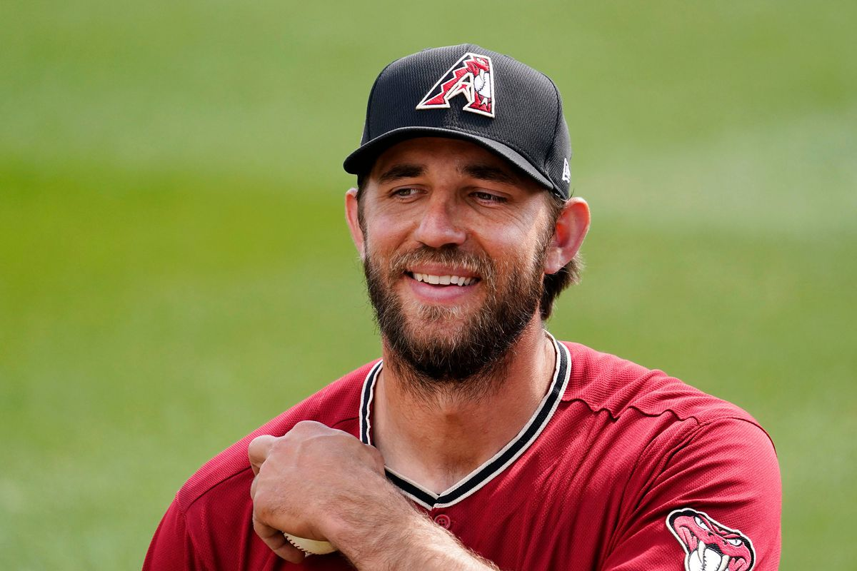 Arizona Diamondbacks starting pitcher Madison Bumgarner warms-up before facing the Los Angeles Angels during a spring training game at Salt River Fields at Talking Stick.