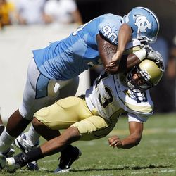 FOR USE AS DESIRED WITH NFL DRAFT STORIES - FILE - In this Sept. 24, 2011, file photo, Georgia Tech quarterback Tevin Washington (13) is hit by North Carolina defensive end Quinton Coples (90) after releasing a pass in the fourth of an NCAA college football game in Atlanta.  Coples is a top prospect in the upcoming NFL football draft.
