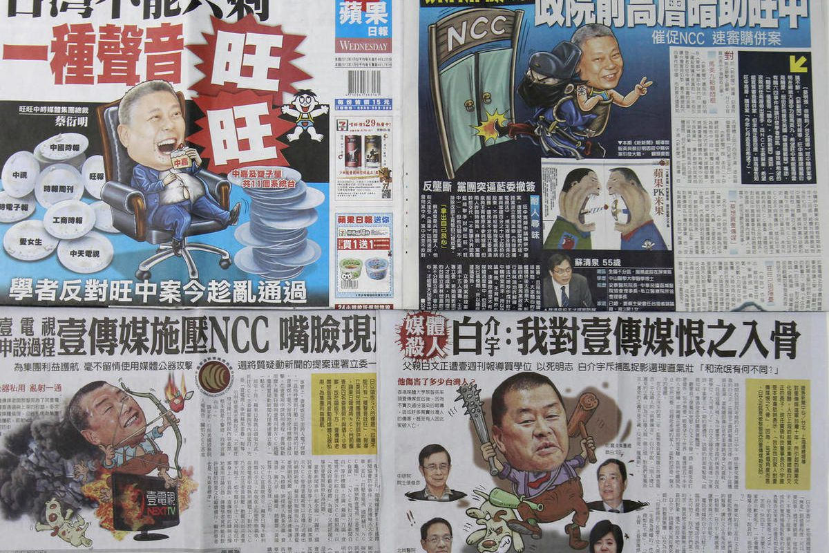 In this image made on Friday, April 27, 2012, pages of rival Taiwan newspapers Apple Daily, top half, and The China Times, bottom, are seen depicting each other's owners in a fight for ownership of a major chunk of Taiwan's media outlets. Hong Kong's medi