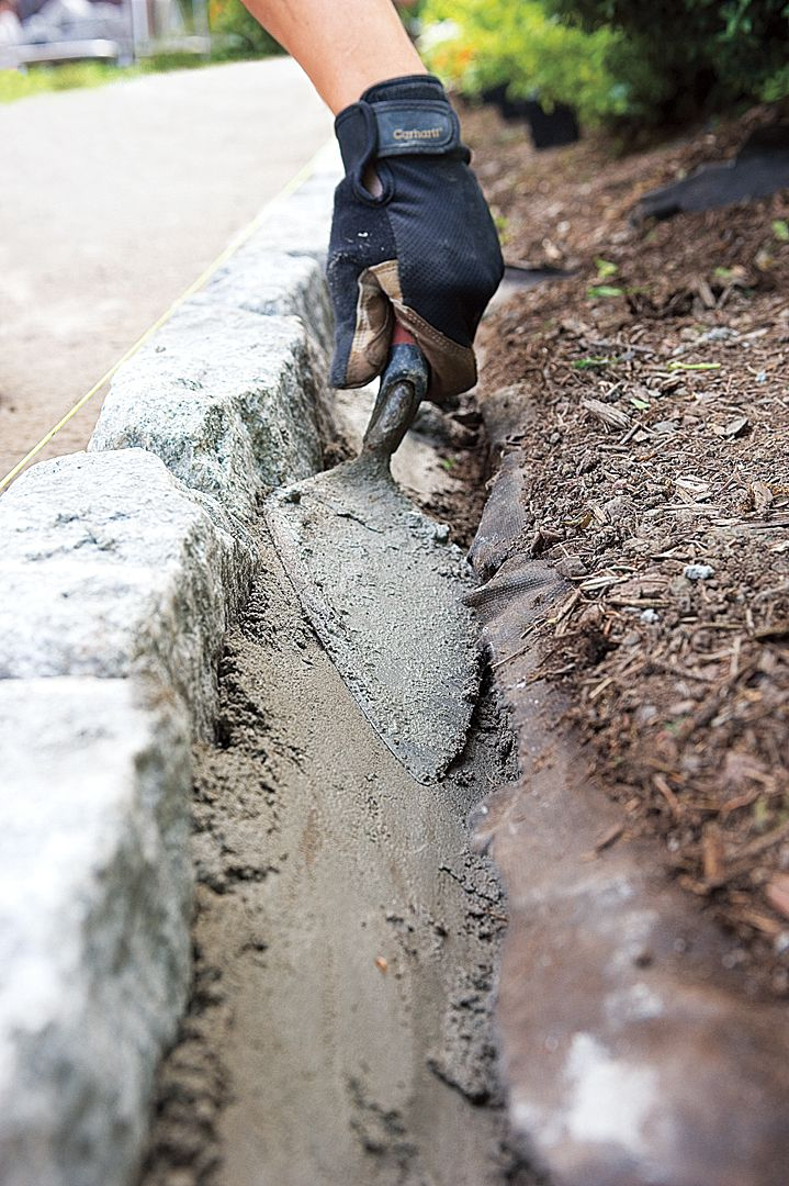 Man Adds More Concrete To Stabilize Belgian Blocks