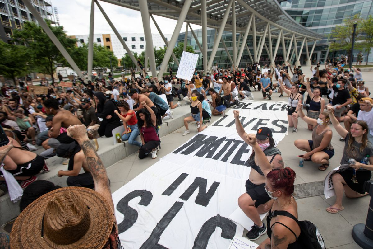 People kneel as they protest police brutality in Salt Lake City on Saturday, May 30, 2020. Daylong protests moved across the city Saturday after a peaceful demonstration to decry the death of George Floyd in police custody in Minneapolis turned violent.