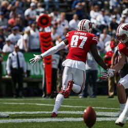 Wisconsin Badgers wide receiver Quintez Cephus (87) celebrates a touchdown reception, putting the Badgers up 17-3 over the Brigham Young Cougars after the PAT, in the first half at LaVell Edwards Stadium in Provo on Saturday, Sept. 16, 2017.