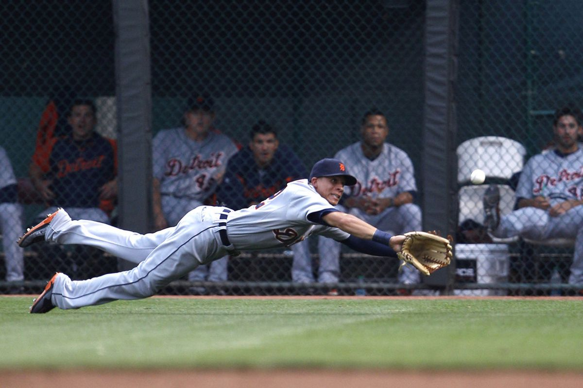 Jun 10, 2012; Cincinnati, OH, USA; Detroit Tigers right fielder Quintin Berry (52) dives for a ball hit by the Cincinnati Reds third baseman Todd Frazier (not pictured) during the second inning at Great American Ball Park.