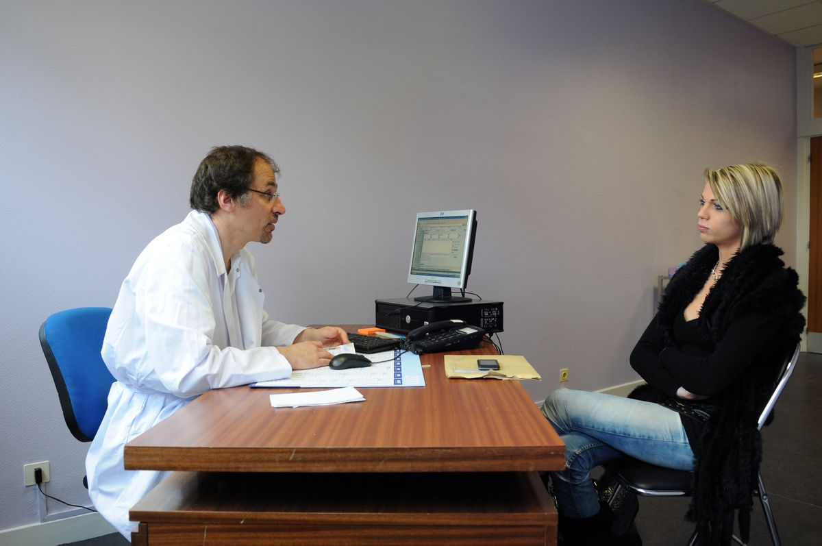 A doctor consults with a transgender patient in Lyon, France.