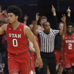 Utah's Sedrick Barefield (0) signals after making a 3-point basket against Saint Mary's during overtime in an NCAA college basketball game in the quarterfinals of the NIT, Wednesday, March 21, 2018, in Moraga, Calif. (AP Photo/Marcio Jose Sanchez)