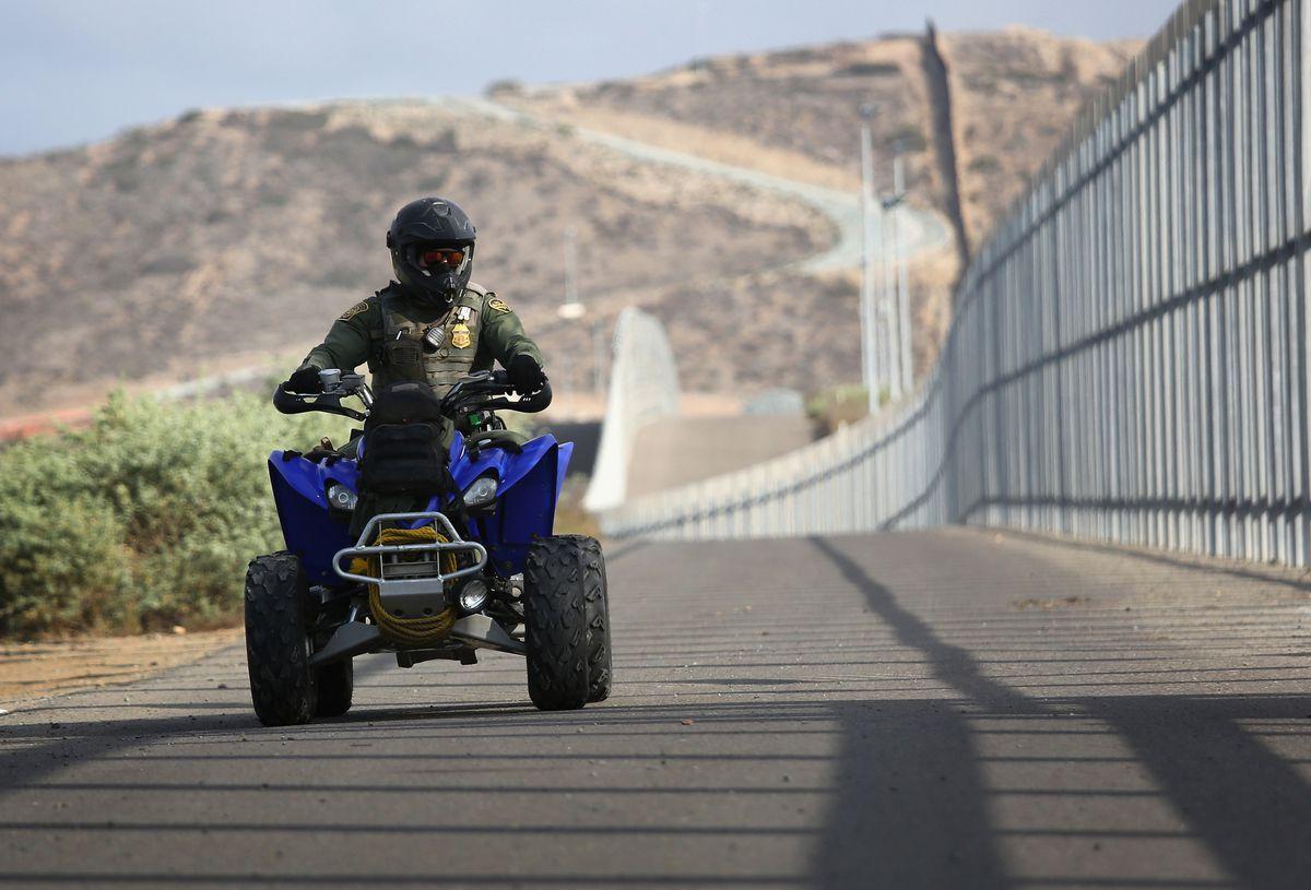 Border patrol agent on ATV