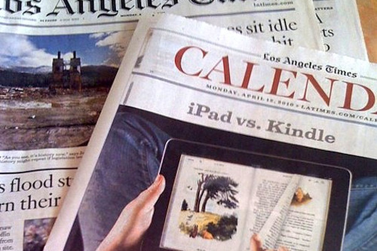 An overhead shot of the LA Times newspaper showing old headlines and the Calendar section.