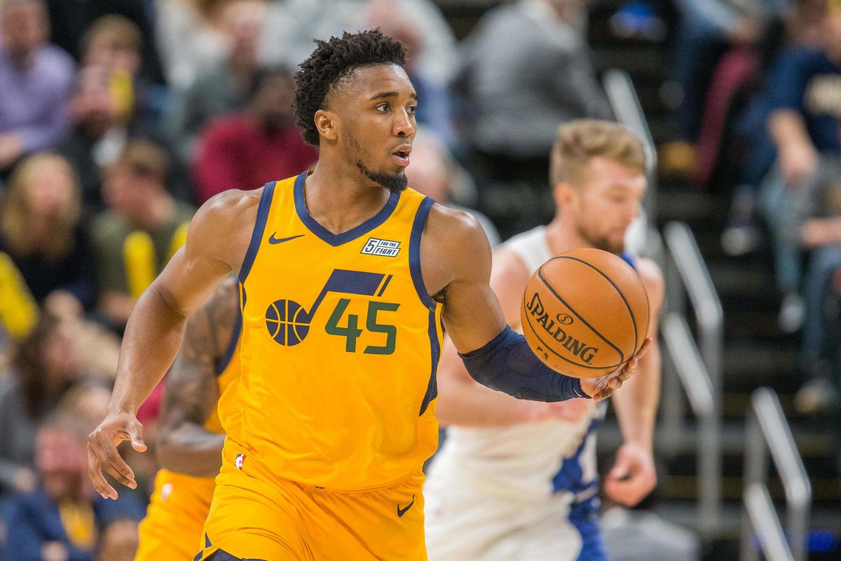 Utah Jazz guard Donovan Mitchell dribbles the ball in the second half against the Indiana Pacers at Bankers Life Fieldhouse.