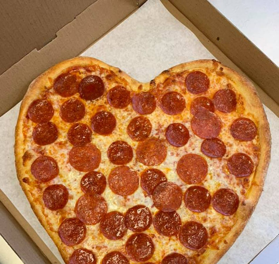 A heart shaped pizza, part of the menu of Italian favorites being created atPizza By Biaggio