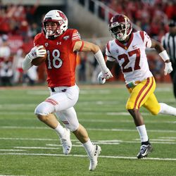Utah wide receiver Britain Covey runs for a touchdown against USC in 2018. Covey served his mission in Chile.