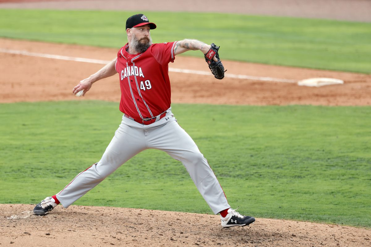 John Axford #49 of Team Canada pitches during the 2021 WBSC Baseball America Qualifier at Clover Park on Saturday, June 5, 2021 in Port St. Lucie, Florida.