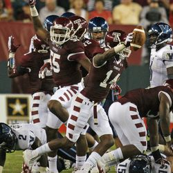 Temple's Vaughn Carraway (14) celebrates after he stripped the ball from Villanova during the first half of an NCAA college football game on Friday, Aug. 31, 2012, in Philadelphia. Carraway ran the ball back for a touchdown.