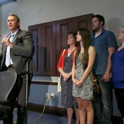 Former Utah Attorney General Mark Shurtleff is surrounded by family while talking about charges of bribery and various other misconduct charges at the law offices of Snow, Christensen & Martineau in Salt Lake City Tuesday, July 15, 2014.