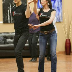 South Salt Lake Businesswoman of the Year Maria Ivanova demonstrates technique with instructor Carlos Gomez Tuesday, March 12, 2013, as they work with her students at her dance studio, DF Dance.