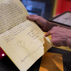 Amy Schulz Johnson, daughter of Peanuts' creator Charles Schulz, shows a letter she received from her father while she was serving an LDS mission in England. Johnson talked about her father during an interview at her home in Alpine Wednesday, Oct. 28, 2015.
