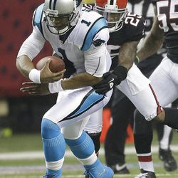 Carolina Panthers quarterback Cam Newton (1) is stopped by Atlanta Falcons strong safety William Moore (25) during the first half of an NFL football game Sunday, Sept. 30, 2012, in Atlanta.