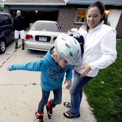 8-year-old Mykenzie Burton races past her mom, Mary, on her roller blades as dad, Kelly, follows behind Sept. 25.